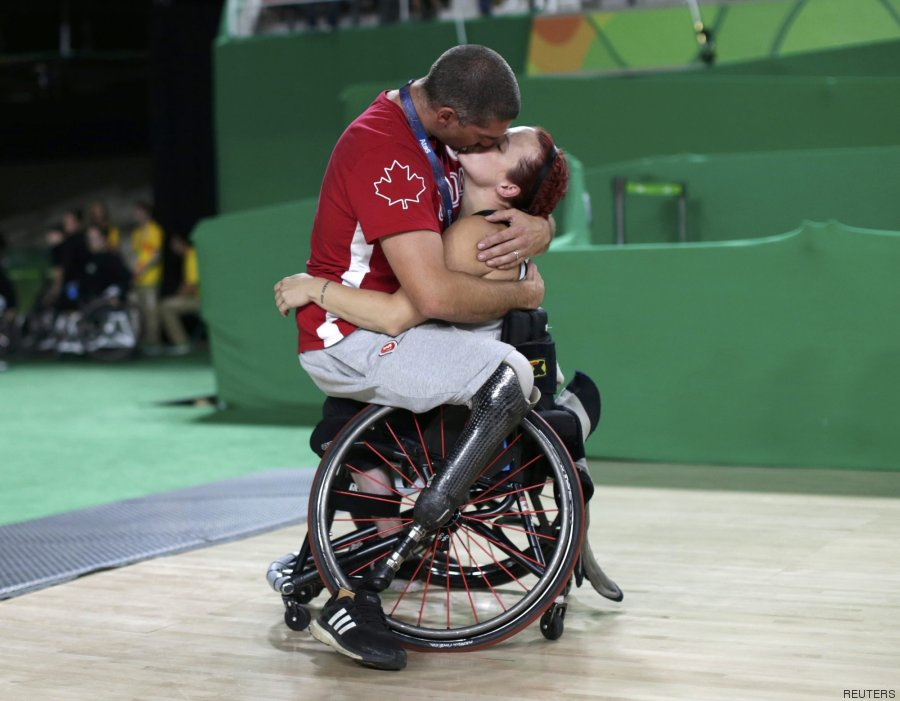 2016 Rio Paralympics - Wheelchair Basketball - Playoff - Women's Playoff - Canada v China - Rio Olympic Arena - Rio de Janeiro, Brazil - 16/09/2016. Canada's men's wheelchair basketball team player Adam Lancia kisses his wife Jamey Jewells of Canada after her match. REUTERS/Ueslei Marcelino TPX IMAGES OF THE DAY FOR EDITORIAL USE ONLY. NOT FOR SALE FOR MARKETING OR ADVERTISING CAMPAIGNS.